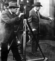 0123198 © Granger - Historical Picture ArchiveD.W. GRIFFITH (1875-1948).   American film producer and director. Griffith (right) and his cameraman 'Billy' Bitzer filming a scene with the actor Henry B. Walthall, c1910-1915.