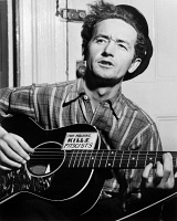 0325313 © Granger - Historical Picture ArchiveWOODY GUTHRIE (1912-1967).   American folk singer. Photograph by Al Aumuller, 1943.