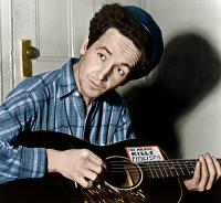 0528036 © Granger - Historical Picture ArchiveWOODY GUTHRIE (1912-1967).   American folk singer. Photograph by Al Aumuller, 8 March 1943.
