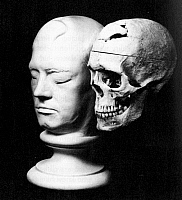 0076174 © Granger - Historical Picture ArchivePHINEAS GAGE (1823-1860).   American railroad foreman and circus performer. Gage's death mask and skull displaying the head wound he received during a railroad construction accident on 13 September 1848.