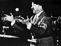 0018139 © Granger - Historical Picture ArchiveADOLF HITLER (1889-1945).   Chancellor of Germany, 1933-45. Addressing Nazi party members in Munich, Germany, 8 November 1942, on the anniversary of the 1923 Nazi putsch.