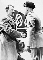 0018143 © Granger - Historical Picture ArchiveHITLER & MUSSOLINI, 1934.   German Chancellor Adolf Hitler being greeted by Italian Prime Minister Benito Mussolini on his arrival in Venice, Italy, 14 June 1934, for talks with the Italian leader.