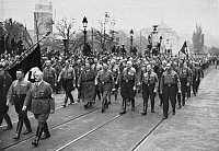 0045336 © Granger - Historical Picture ArchiveADOLF HITLER (1889-1945).   Chancellor of Germany, 1933-45. Hitler and members of the Third Reich reenact the Munich March of 9 November 1923, in 1934.