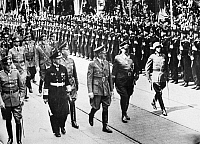 0046868 © Granger - Historical Picture ArchiveADOLF HITLER (1889-1945).   Chancellor of Germany, 1933-45. Hitler reviewing a detachment of sailors and troops in Berlin, Germany, 6 July 1940. To his left stands Field Marshal Hermann Göring and to his right, Grand Admiral of the Fleet Erich Raeder.