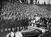 0111440 © Granger - Historical Picture ArchiveADOLF HITLER (1889-1945).   Chancellor of Germany, 1933-45. Hitler saluting the Hitler Youth at a Nazi Party rally, 1934.