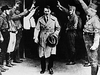 0173140 © Granger - Historical Picture ArchiveADOLF HITLER (1889-1945).   Chancellor of Germany, 1933-45. Hitler leaving a meeting. Photograph, c1933.