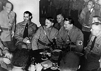 0173505 © Granger - Historical Picture ArchivePUTSCH ANNIVERSARY, 1937.   Leaders of the Third Reich celebrate the anniversary of the 1923 Beer Hall Putsch at the beer hall in Munich where it was launched. Left to right: Franz Ritter, Rudolf Hess, Adolf Hiter, Hermann Goering, and Max Amann. Photograph, 9 November 1937.