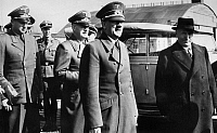 0173536 © Granger - Historical Picture ArchiveHITLER AND MUSSOLINI, c1940.   German Chancellor Adolf Hitler and Italian Prime Minister Benito Mussolini. To the left of Hitler is Joachim von Ribbentrop. Photograph, c1940.