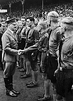 0216819 © Granger - Historical Picture ArchiveHITLER YOUTH, 1937.   Adolf Hitler shaking hands with Hitler Youth at a stadium in Nuremberg, Germany. Photograph, 1937.