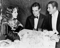 0621604 © Granger - Historical Picture ArchiveHOWARD HUGHES (1905-1976).   American industrialist, aviator, and film producer. Hughes (center) with actress Helen Gilbert and actor Errol Flynn. Photographed at a charity Christmas party in Beverly Hills, California, 1939.