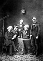 0101562 © Granger - Historical Picture ArchiveFAMOUS SCIENTISTS.   Fictitious group portrait of famous British scientists. Michael Faraday, Thomas Henry Huxley, Charles Wheatstone, David Brewster, and John Tyndall. Lithograph, 19th century.