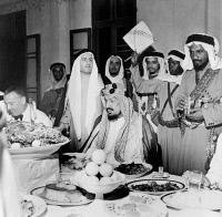 0634015 © Granger - Historical Picture ArchiveABDUL-AZIZ IBN-SAUD   (1880-1953). King of Saudi Arabia, 1932-1953. At a banquet with Army Air Force General Ralph Royce in Saudi Arabia. Photograph, c1944.