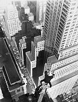 0176709 © Granger - Historical Picture ArchiveALVIN 'SHIPWRECK' KELLY   (c1893-1952). American stunt actor and champion flagpole sitter. Kelly dunking donuts while doing a handstand on top of the Chanin Building in New York City, c1933.