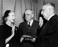0622108 © Granger - Historical Picture ArchiveCLARE BOOTHE LUCE   (1903-1987). American playwright, diplomat and Congresswoman. Being sworn in as Ambassador to Italy by Chief Justice Fred Vinson, while Secretary of State John Foster Dulles observes. Photograph, 1953.