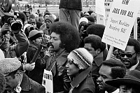 0126167 © Granger - Historical Picture ArchiveJESSE JACKSON (1941- ).   American civil rights leader. Speaking into a microphone at a rally outside the White House in support of the Humphrey-Hawkins bill for full employment, 15 January 1975. Photographed by Thomas J. O'Halloran.