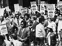 0128473 © Granger - Historical Picture ArchiveJESSE JACKSON (1941- ).   American civil rights leader. Jackson (center, without jacket) at an Operation PUSH (People United to Save Humanity) demonstration for jobs and higher wages, Chicago, Illinois, 1973.