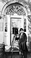 0126361 © Granger - Historical Picture ArchiveFRANCES BENJAMIN JOHNSTON   (1864-1952). American photographer, with her camera in front of a building, c1935.