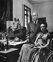 0033461 © Granger - Historical Picture ArchiveFRIDA KAHLO (1907-1954).   Mexican painter. Photographed by Gisele Freund with her doctor and painting of the two of them. Mexico City, 1951.