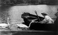 0110532 © Granger - Historical Picture ArchiveHELEN ADAMS KELLER   (1880-1968). American writer and lecturer. Photographed sitting in a rowboat feeding the swans, c1913.