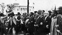 0075166 © Granger - Historical Picture ArchiveMARTIN LUTHER KING, JR.   (1929-1968). American clergyman and reformer. Dr. King (fourth from right) leading the march from Selma on the state capitol at Montgomery, Alabama, 25 March 1965.