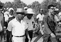 0169654 © Granger - Historical Picture ArchiveKING AND MEREDITH, 1966.   James Meredith (with cane) and Martin Luther King, Jr., during the 'Freedom March' from Canton, Mississippi to the Tougaloo College campus, 25 June 1966.