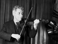 0168644 © Granger - Historical Picture ArchiveFRITZ KREISLER (1875-1962).   American (Austrian-born) violinist and composer. Photographed at the RCA Victor offices in Camden, New Jersey, 1942.
