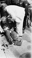 0168710 © Granger - Historical Picture ArchiveFRITZ KREISLER (1875-1962).   American (Austrian-born) violinist and composer. A doctor administers care to Kreisler after he was struck by a truck at 57th Street and Madison Avenue in New York City, 26 April 1941.