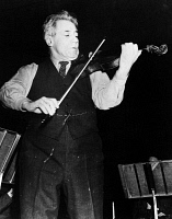 0168713 © Granger - Historical Picture ArchiveFRITZ KREISLER (1875-1962).   American (Austrian-born) violinist and composer, performing for the first time since he was struck by a truck in New York City in April 1941. Photograph, 16 January 1942.