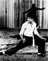 0116900 © Granger - Historical Picture ArchiveBRUCE LEE (1940-1973).   Chinese-American martial artist and actor. In scene from the film 'Fists of Fury' (also known as 'The Big Boss'), 1971.