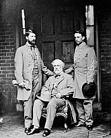 0163571 © Granger - Historical Picture ArchiveROBERT E. LEE (1807-1870).   American Confederate general. General Lee (center) with his son, Major General George Washington Custis Lee (left), and his aide-de-camp, Colonel Walter Taylor, on the back porch of the Lee home at Richmond, Virginia, April 1865. Photographed by Mathew Brady.