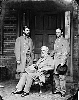 0163572 © Granger - Historical Picture ArchiveROBERT E. LEE (1807-1870).   American Confederate general. General Lee (center) with his son, Major General George Washington Custis Lee (left), and his aide-de-camp, Colonel Walter Taylor, on the back porch of the Lee home at Richmond, Virginia, April 1865. Photographed by Mathew Brady.