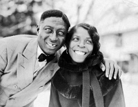 0118961 © Granger - Historical Picture ArchiveHUDDIE LEDBETTER   (1889-1949).   Known as 'Leadbelly'. American folk musician. Photographed with his wife, Martha in Wilton, Connecticut. Photograph by Alan Lomax in Feburary 1935.