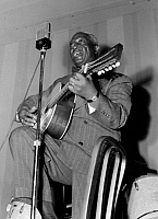 0267126 © Granger - Historical Picture ArchiveHUDDIE LEDBETTER   (1889-1949). Known as 'Lead Belly'. American folk musician. Performing at the National Press Club in Washington, D.C. Photograph by William P. Gottlieb, c1942.