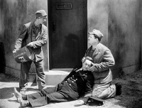 0006216 © Granger - Historical Picture ArchiveLAUREL AND HARDY, 1931.   Stan Laurel (left) and Oliver Hardy (right) in a scene from 'Pardon Us' (originally entitled 'The Rap'), 1931.