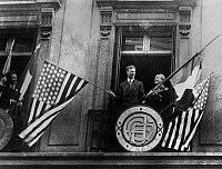 0169708 © Granger - Historical Picture ArchiveCHARLES A. LINDBERGH   (1902-1974). American aviator. Lindbergh waving the American and French flags from the balcony of the Aero Club de France in Paris, following his historic transatlantic solo flight of 20-21 May 1927.