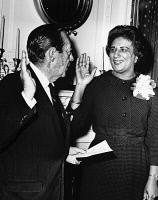0528071 © Granger - Historical Picture ArchiveCONSTANCE BAKER MOTLEY   (1921-2005). American civil rights activist, lawyer, judge, and politician. Being sworn in by Mayor Robert Wagner as Borough President of Manhattan. Photograph, February 1965.