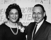 0528072 © Granger - Historical Picture ArchiveCONSTANCE BAKER MOTLEY   (1921-2005). American civil rights activist, lawyer, judge, and politician. With her husband Joel at her swearing in as the Borough President of Manhattan. Photograph, February 1965.