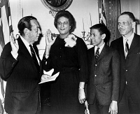 0528073 © Granger - Historical Picture ArchiveCONSTANCE BAKER MOTLEY   (1921-2005). American civil rights activist, lawyer, judge, and politician. Being sworn in by Mayor Robert Wagner as Borough President of Manhattan, as her husband and son look on. Photograph, February 1965.