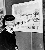 0621658 © Granger - Historical Picture ArchiveANNA MARY ROBERTSON   (1860-1961). Known as Grandma Moses. American folk artist. With one of her paintings at an exhibition in Madison Square Garden, New York. Photograph, 1945.