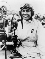 0621753 © Granger - Historical Picture ArchiveJESSIE MILLER (1902-1972).   Australian aviator. Miller holding the first prize trophy she won at the women's speed race of the National Air Races in Cleveland, Ohio. Photograph, 1929.