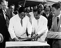 0176685 © Granger - Historical Picture ArchiveNGO DINH DIEM (1901-1963).   Vietnamese political leader. As President of South Vietnam (left foreground), being assisted by an unidentified official as he lays the foundation stone for the Da Nhim hydroelectric power plant, in Lam Dong province, financed in part through reparation funds from Japan, 1 April 1961.