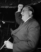 0169839 © Granger - Historical Picture ArchiveWALTER O'MALLEY (1903-1979).   American sports executive. As President of the Brooklyn Dodgers, cheering the team on to victory over the New York Yankees in Game 3 of the 1952 World Series at Yankee Stadium in the Bronx, New York City, 3 October 1952.