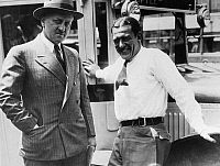 0170504 © Granger - Historical Picture ArchiveCHARLES C. PYLE (1882-1939).   Known as C.C. Pyle. American sports promoter and showman. Photographed with one of his clients, star football player Harold 'Red' Grange (right), while passing through St. Louis, Missouri, in the motor caravan that accompanied the Trans-American footrace, 28 April 1928.