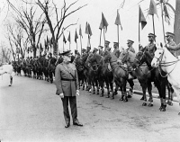 0623319 © Granger - Historical Picture ArchiveJOHN JOSEPH PERSHING   (1860-1948). American army commander. Reviewing mounted African American soldiers, Fort Myer, Virginia. Photograph, 1932.