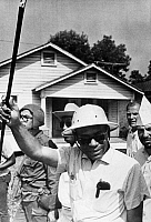 0115666 © Granger - Historical Picture ArchiveJAMES MEREDITH (1933- ).   American civil rights leader. Meredith wearing a pith helmet and carrying an ebony cane, continuing his 'Freedom March' from Canton, Mississippi to the Tougaloo College campus on 25 June 1966, after recovering from an assassination attempt on 5 June.