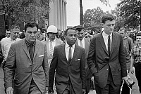 0268808 © Granger - Historical Picture ArchiveJAMES MEREDITH (1933- ).   American civil rights leader. Being escorted by U.S. marshals on the University of Mississippi campus, as its first African-American student. Photograph by Marion S. Trikosko, 1 October 1962.