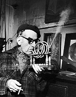 0133740 © Granger - Historical Picture ArchiveMAN RAY (1890-1976).   Originally Emmanuel Rudnitsky. American painter, photographer and filmmaker. Man Ray demonstrating his 'Smoking Device,' 1964.