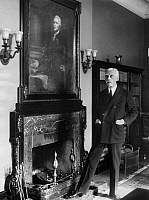 0114629 © Granger - Historical Picture ArchiveANDREW MELLON (1855-1937).   American financier. U.S. Treasury Secretary Andrew Mellon in his office at the Treasury Department, Washington, D.C., in 1927 alongside a painting of the first U.S. Secretary of the Treasury, Alexander Hamilton.