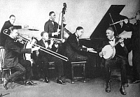 0029436 © Granger - Historical Picture Archive'JELLY ROLL' MORTON   (1885-1941). Ferdinand Joseph La Menthe. American musician. Jelly Roll Morton (at piano) with his group, The Red Hot Peppers, 1926.