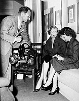 0115506 © Granger - Historical Picture ArchiveMARILYN MONROE (1926-1962).   American cinema actress. Monroe in her dressing room at Fox Studios with journalist Aline Mosby and photographer George Long, 1952.